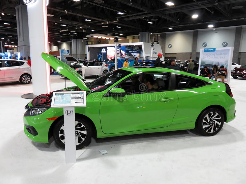 Green Honda Civic Couple at the Auto Show royalty free stock photography