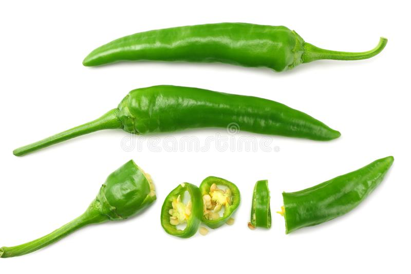 Green hot chili peppers with slices isolated on white background top view stock image