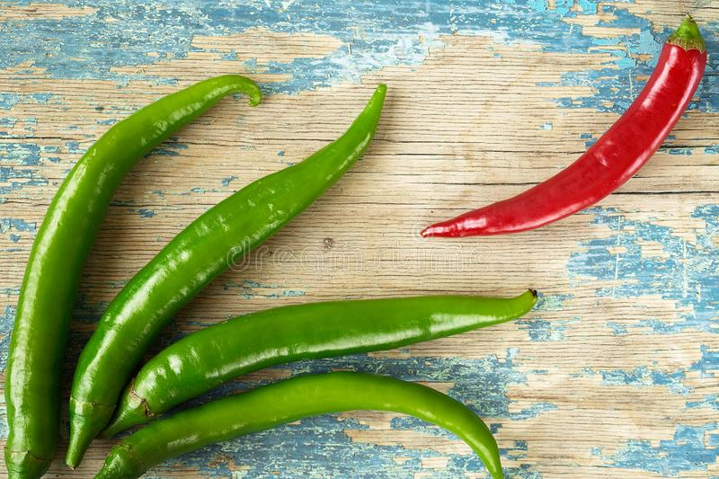 Green hot pepper on rustic wooden background. Culinary background. Top view with copy space stock image