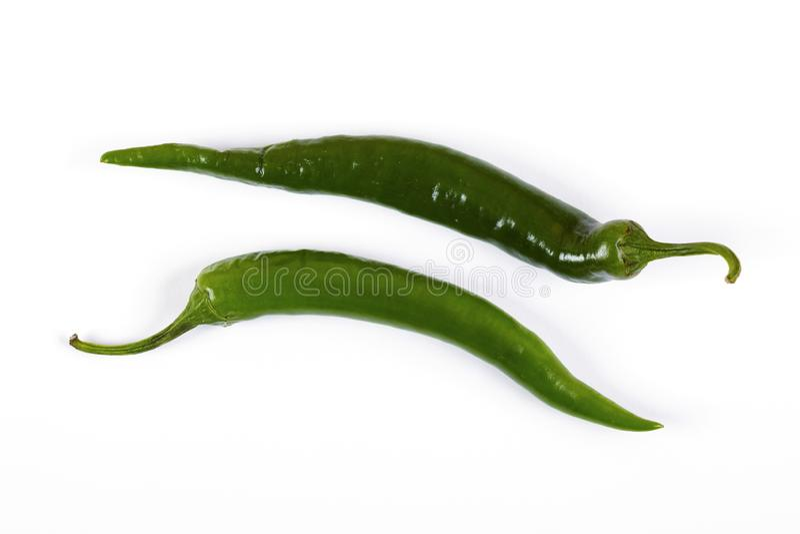 Green hot pepper. On white bacground. Macro shot royalty free stock image