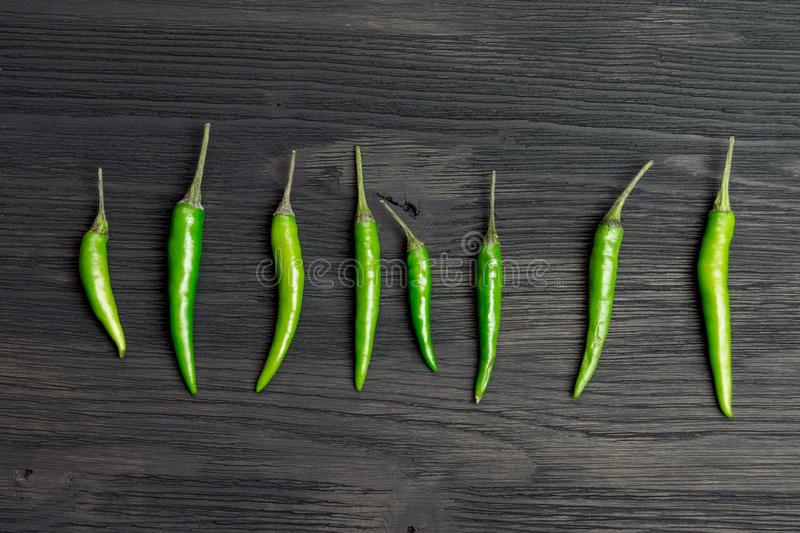 Green hot pepper. On a wooden table royalty free stock photos