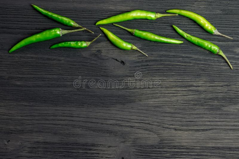 Green hot pepper on a wooden table. Copyspace royalty free stock image