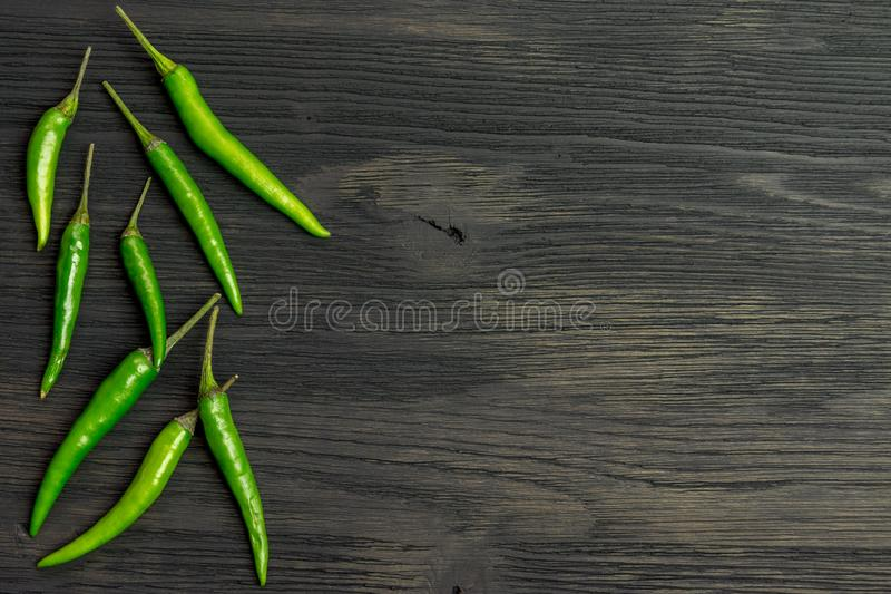Green hot pepper on a wooden table. Copyspace royalty free stock photo