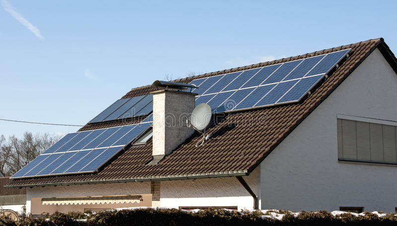 Green house. A house with a photovoltaic power plant on its roof royalty free stock photos