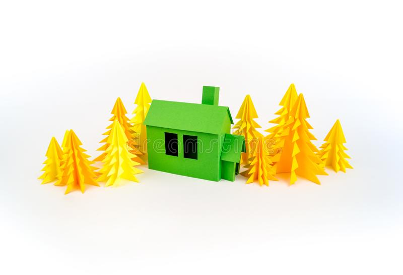 Green house glued out of paper stands in the yellow forest royalty free stock photography