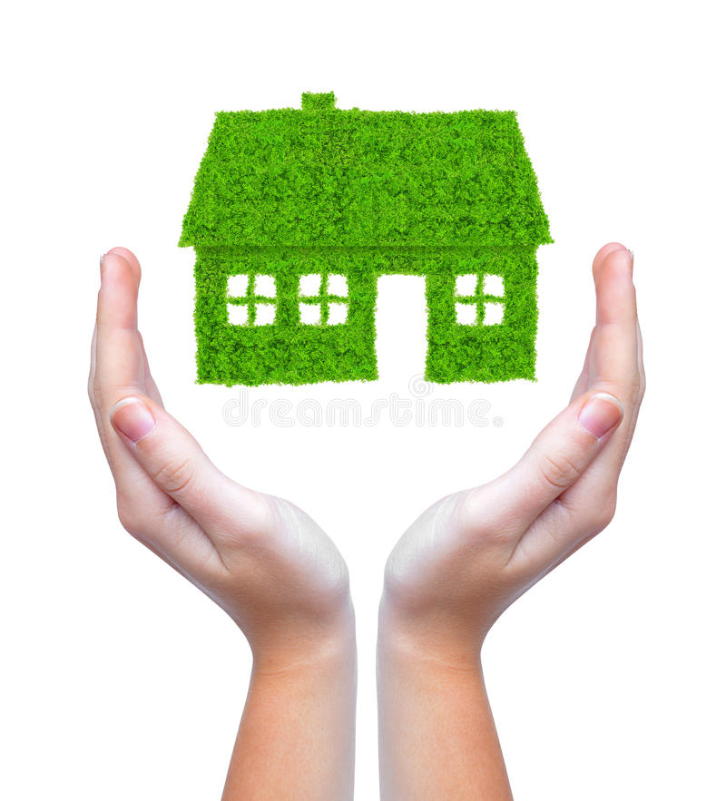 Green House In Hands Stock Photo