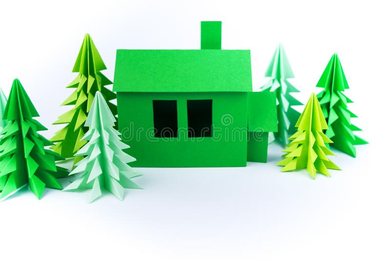 Green house paperwork standing on a white background. Paper craft. Forest christmas tree. Children`s crafts handmade stock photo
