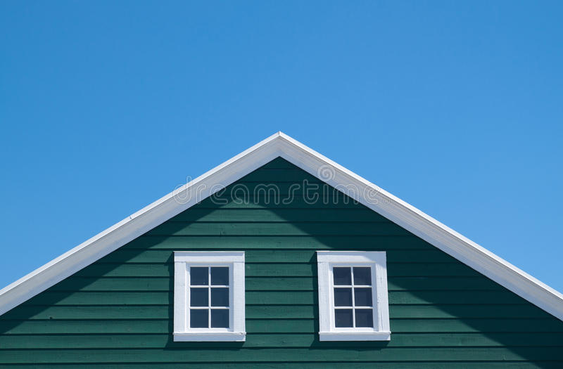 Green house and white roof with blue sky. In sunny day stock image