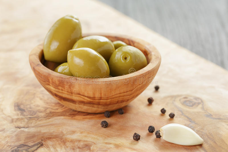 Image result for olives on wooden table