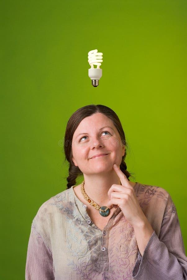 Green idea. An environmentalist has a green idea stock photography