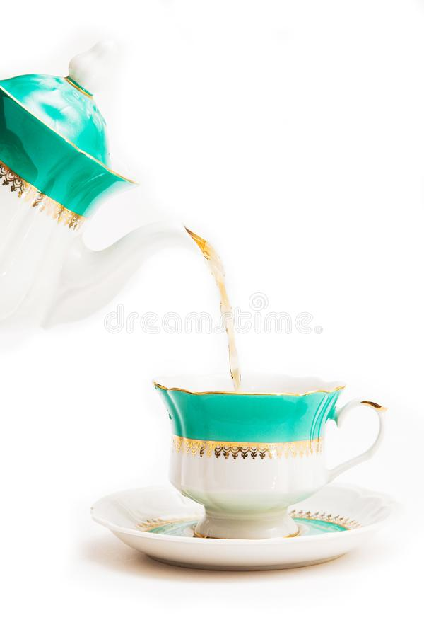 Green indian cup of tea and kettle on white background. Isolated on white. Indian dishes royalty free stock image