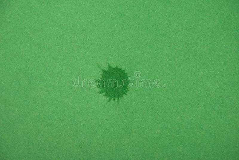Green ink blot on green background. Close-up stock image