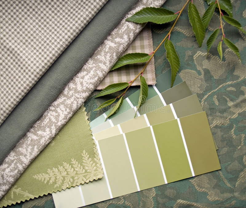 Green interior decoration plan. Green paint sample and fabric swatches stock images