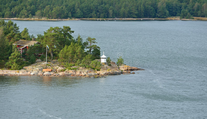 Green Island with red house and lighthouse. Aland Islands, Finland royalty free stock photos
