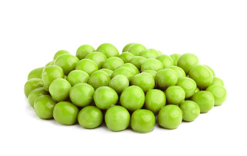 green isolerade ärtor arkivfoton