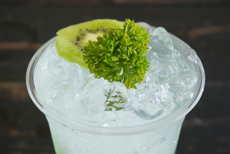 Green Italian Soda Cold Beverage and Kiwi Fruit and Parsley Center stock photos