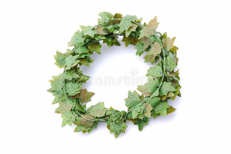 Green ivy wreath. A green artificial English ivy wreath. Image isolated on white studio background royalty free stock photos