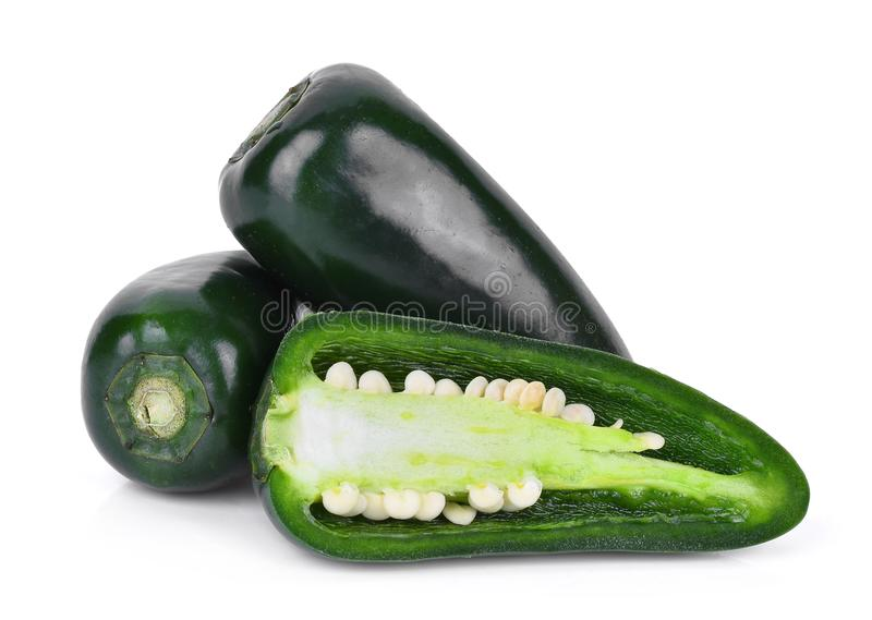 Green jalapeno peppers with half slice isolated on a white royalty free stock photo