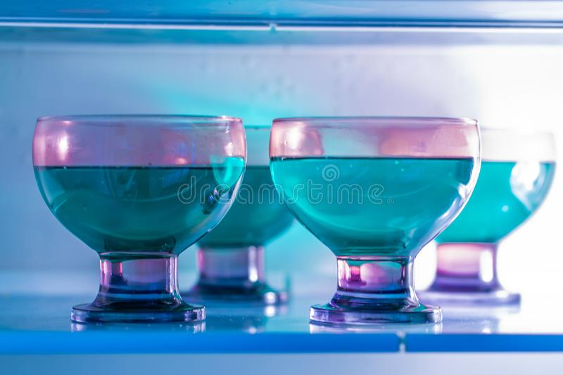 Green jelly in purple dishes royalty free stock photo