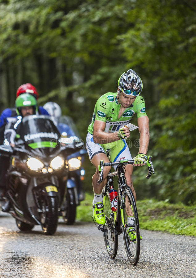 Green Jersey - Peter Sagan. Col de Platzerwasel, France - July 14, 2014: The Slovak Cyclist Peter Sagan (Cannondale Team),wearing The Green Jersey, checks the royalty free stock photo