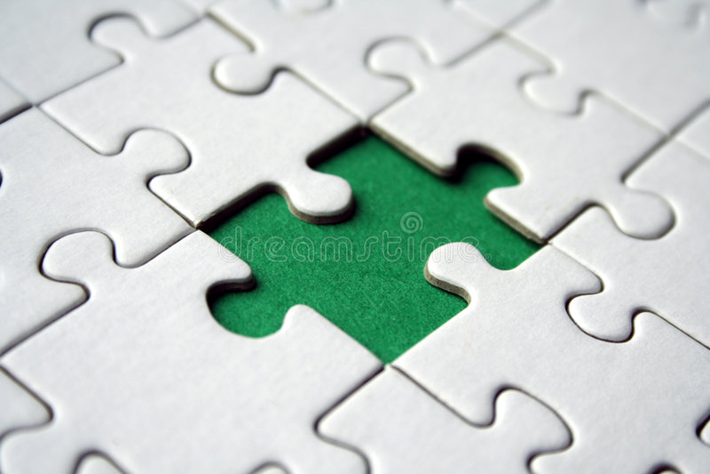 Green jigsaw element royalty free stock image