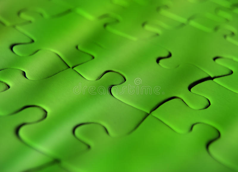 Green jigsaw puzzle stock photography