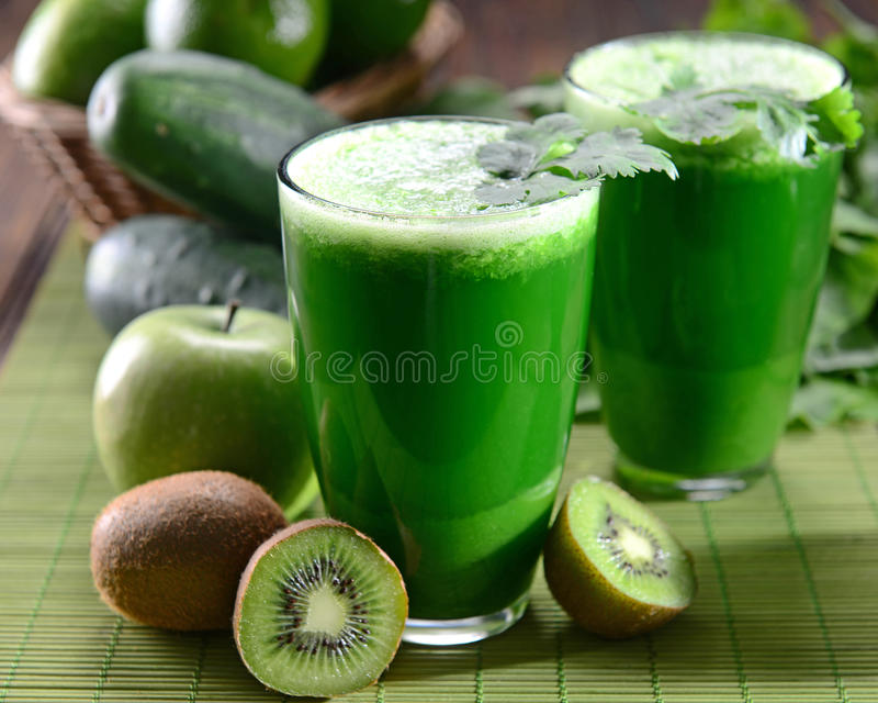 Green Juice. Two glasses of green juice royalty free stock photo