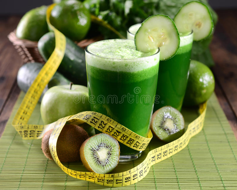 Green Juice. Two glasses of green juice royalty free stock images