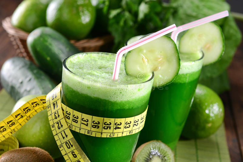 Green Juice. Two glasses of green juice royalty free stock photography