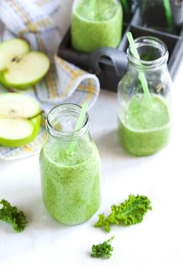 Green juice in bottle. Healthy drink stock photo