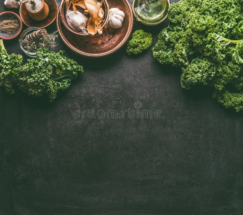 Green kale food background on dark rustic kitchen table. Healthy detox vegetables . Clean eating and dieting concept. Top view stock photography