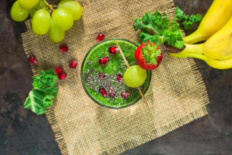 Green kale and grapes smoothie. Healthy green kale and grapes smoothie garnished with chia and pomegranate seeds stock photography