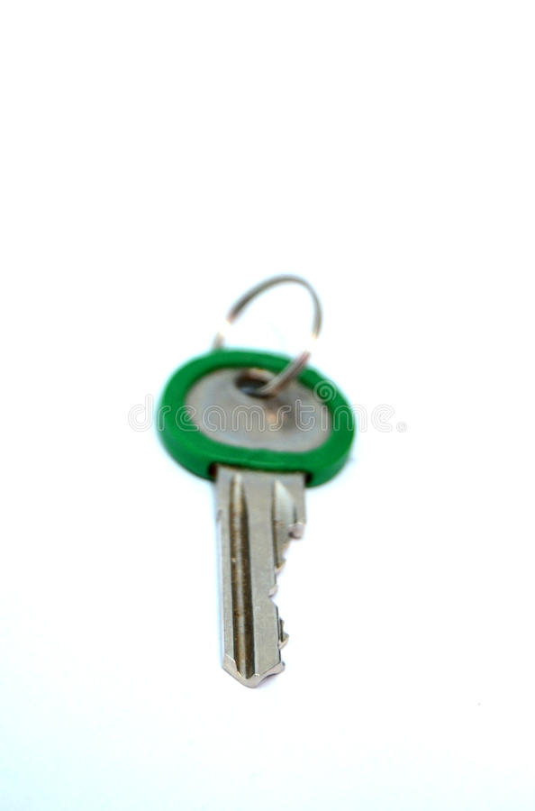 Green key. Picture of a Old used Green key stock photography
