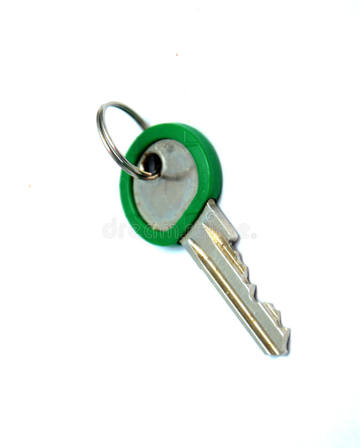 Green key. Picture of a Old used Green key royalty free stock image