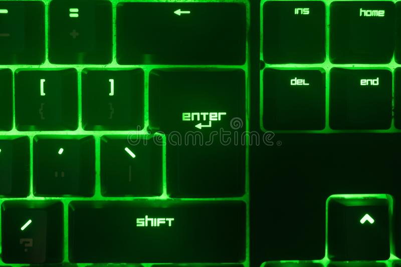Green keyboard. Technology gaming gadget. royalty free stock photo