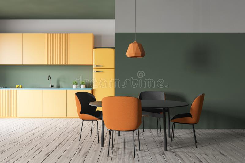 Green kitchen with yellow counters and table royalty free illustration