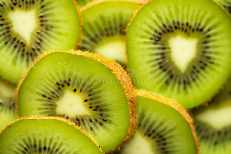 Kiwi slices and light. Green kiwi slices and light royalty free stock image