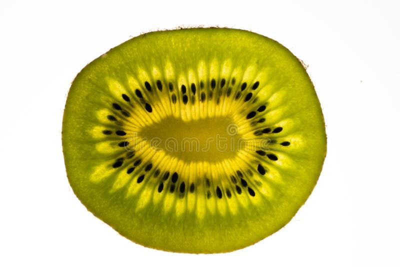 Kiwi slices and light stock photography