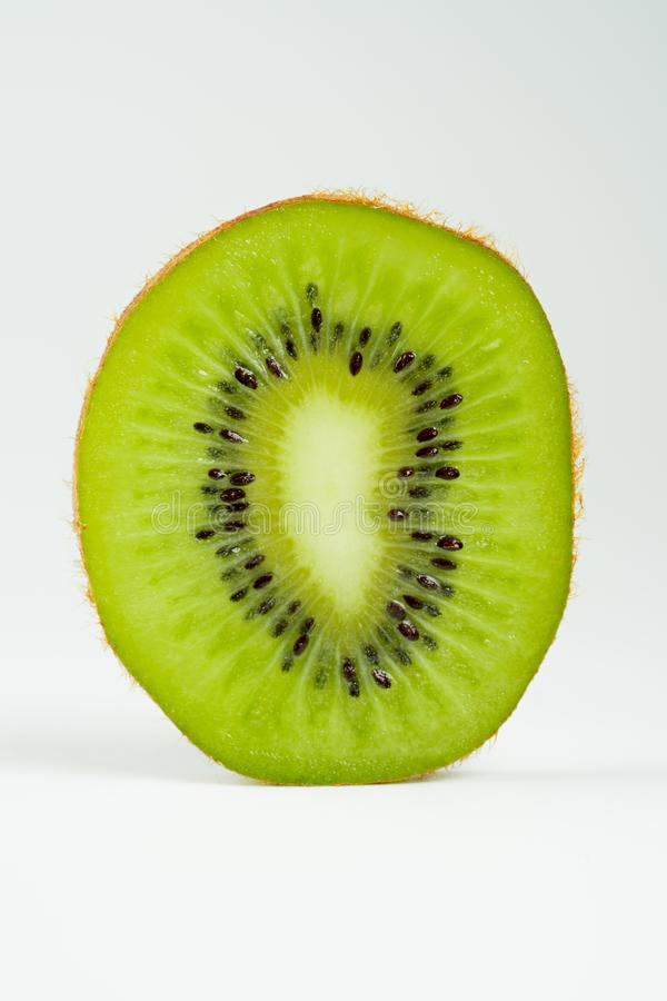 Kiwi slices and light. Green kiwi slices and light stock photo
