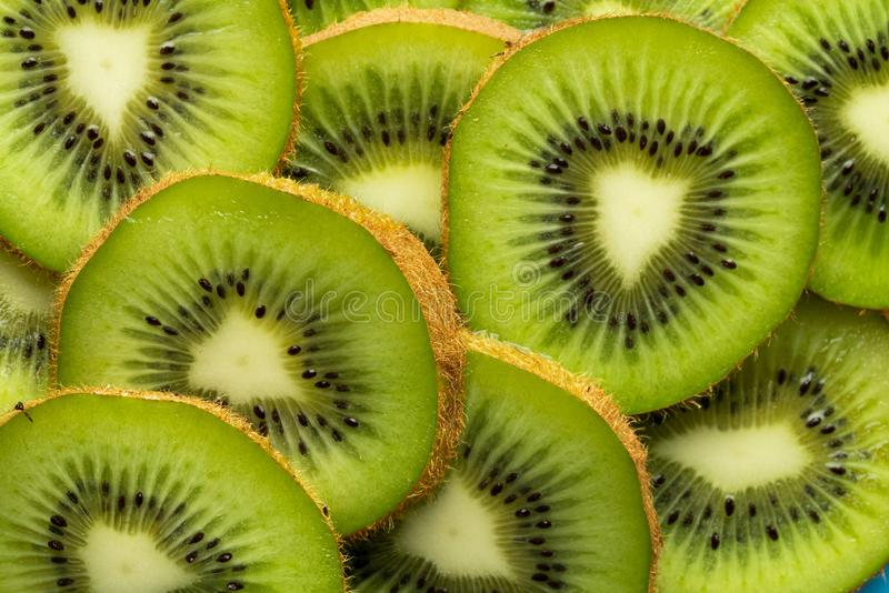Kiwi slices and light royalty free stock image