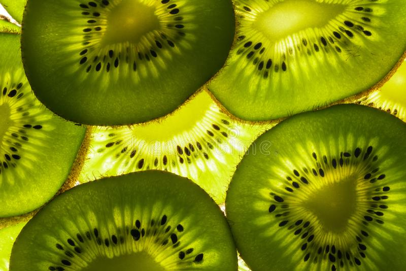 Kiwi slices and light royalty free stock photography