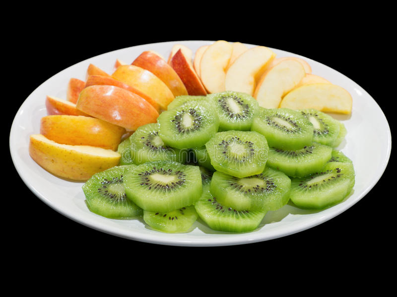 Green kiwi slices and red apple slices isolated on the black background with clipping path.  royalty free stock image