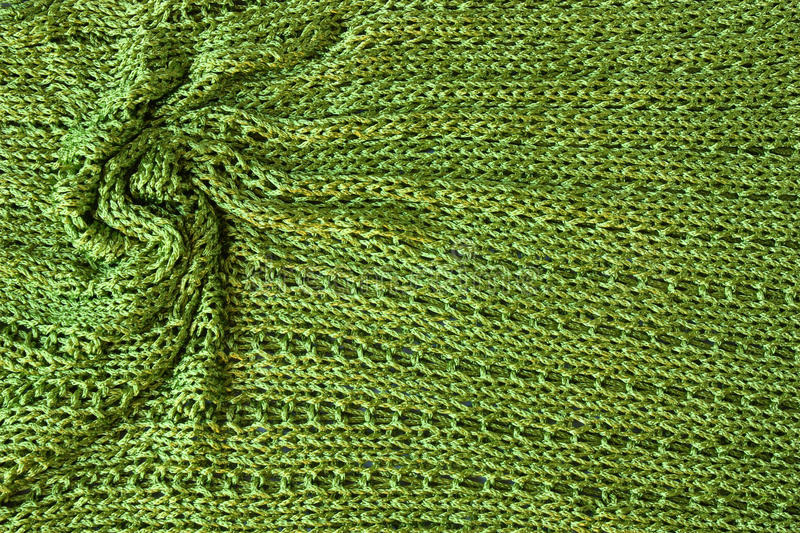 Green Knit Background With Twisted Folds Stock Photo