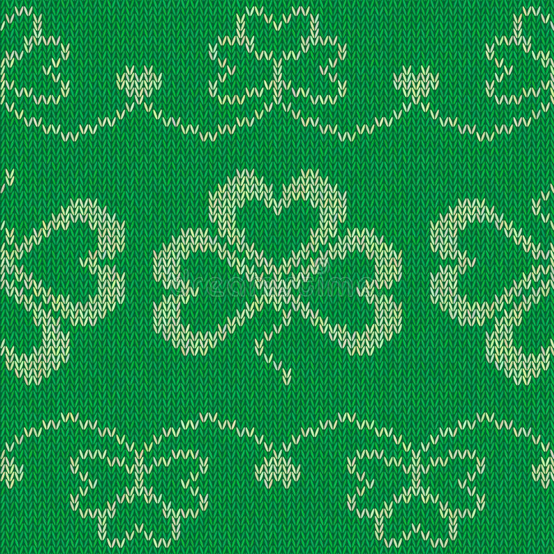 Green knitted clovers seamless pattern stock image