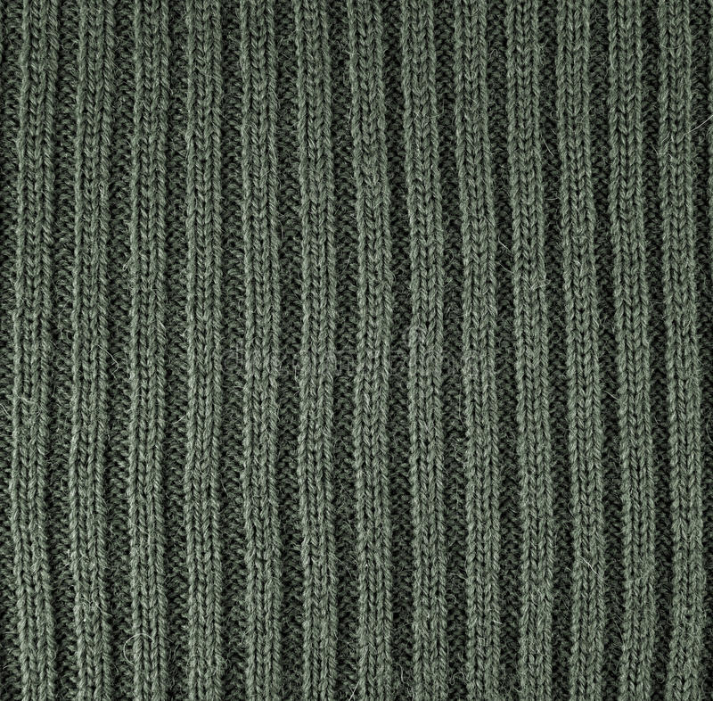 Green knitted wool background. Abstract green knitted wool background royalty free stock image