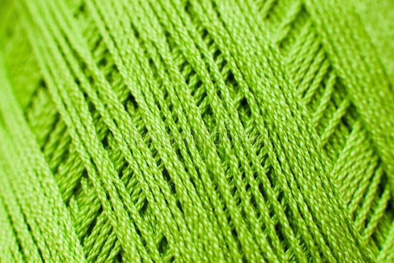 Green knitting thread texture, handiwork backdrop. Bright handiwork background, crochet iris string, Leisure, hobby, needlework concept royalty free stock photos