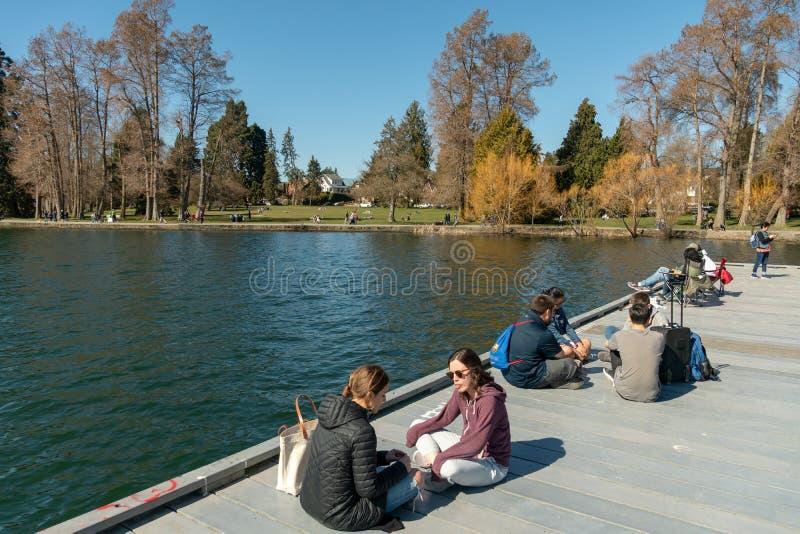 Green lake dock. Seattle, Washington - 2019-03-17 - People enjoying spring has started in Greenlake as Spring begins in Seattle royalty free stock photo