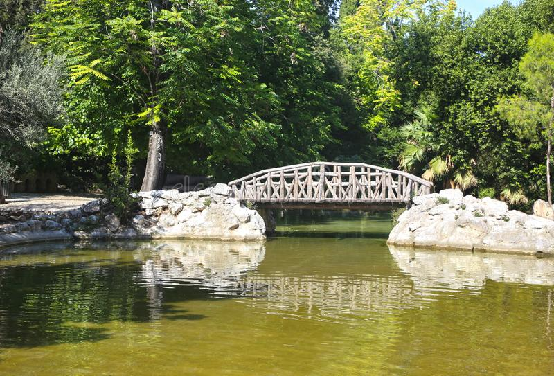 Green lake scene at the National Garden of Athens Greece royalty free stock photography