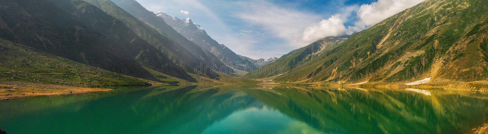 Green Lake Surrounded by Mountain royalty free stock photos