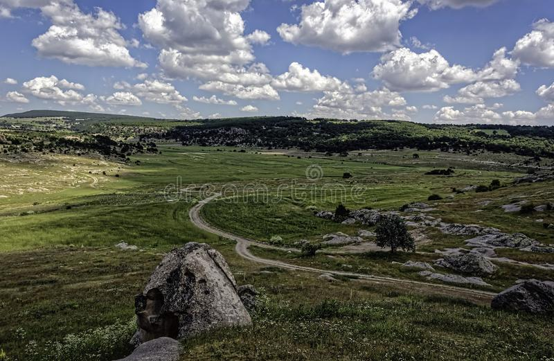 Green landscape with blue sky and fluffy clouds. View from Doganli Kale, Cukurca Village, Phrigia, Eskisehir, Turkey stock photography